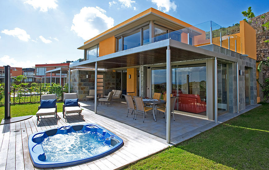 Two storey villa with modern design, large glass windows and a pleasant outdoor area with jacuzzi